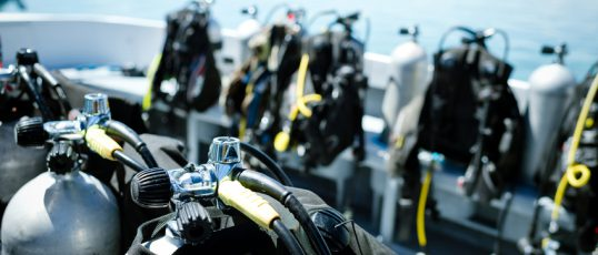 Close-up of underwater diving equipments on boat.